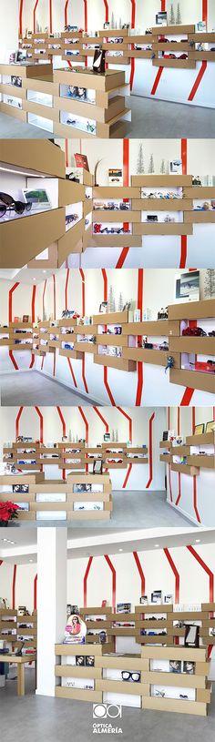 Interior design for an amazing optics! Cardboard displays for glasses and furniture designed by Cartonlab. #interiordesign #retailstore #retailideas