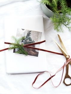 white wrapping inspiration with brown velvet ribbon and a print from inkifi