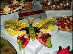 This is an amazing fruit salad in the shape of a butterfly.