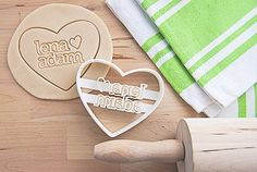 White, heart shaped cookie cutter, made of biodegradable, food-safe plastic, customized with your names, complete with a tiny hand-drawn heart, and