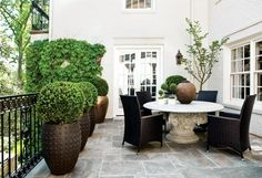 Love the table and chairs.  The bushes in the pots are super cute too!