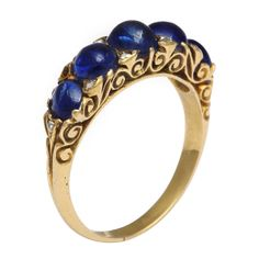 Victorian gold ring featuring five cabochon sapphires set in an openwork mount. English, circa 1880.