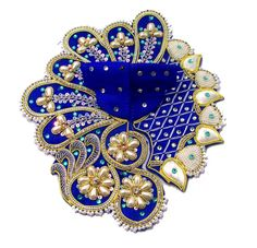 Shyamkali Moti Zari Poshak is a uniquely designed Blue Laddu Gopal dress with Flower & Petal pattern. This  Designer dress is made with perfectly finished and durable decorative Zari & Pearl work.    There are different color embroidery and other types of work on the Poshak giving it a stunning appearance.     - See more at: http://www.divinekraft.com/POSHAK---DRESS/Shyamkali-Moti-Zari-Poshak-id-1785121.html#sthash.iWAvSuVL.dpuf