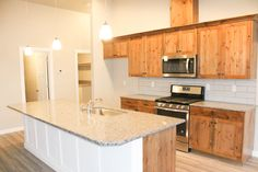 Beautiful custom cabinets in our Shoshone floorplan. Home built by Agile Homes Luxury Packaging, Home Pictures, Custom Cabinets, Building A House, House Plans, Kitchen Cabinets, New Homes, Floor Plans, Flooring
