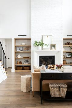 Beautiful living room design with warm woods and bright whites, built in shelves and white painted brick fireplace - Studio McGee Beautiful Living Rooms, Cozy Living Rooms, Home Living Room, Interior Design Living Room, Living Room Designs, Barn Living, Living Room Stairs, Living Room Fireplace, Brick Fireplace Remodel