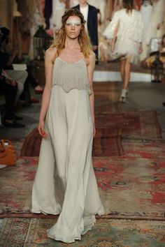 How pretty is this ethereal wedding dress and its fringed top?!