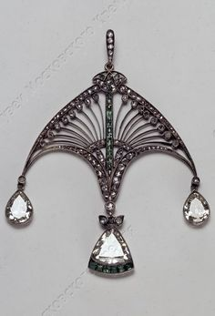 Carl Fabergé - An antique silver alloy, diamond and emerald pendant, Moscow, early 20th century. 6 x 4.8cm. #Faberge #antique