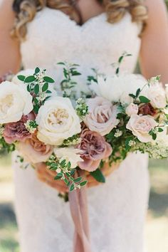This romantic pink and white rose bouquet was featured in a real wedding from California on The Knot. Like what you see? View the full wedding album and get more pastel summer wedding ideas. Personalize your wedding and put a spin on tradition with The Knot's customizable wedding websites, wedding invitations, registry (and more!). Not sure where to start? Get ideas and advice from our editors on everything from wedding colors and venue types to all things guest.