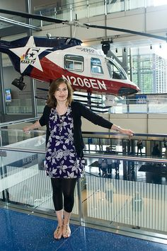 Famous Faces at the Newseum.  Mariska Hargitay strikes a pose on a walkway overlooking the The New York Times–Ochs-Sulzberger Family Great Hall of News which features a Bell helicopter (seen in the background).  Photo credit: Maria Bryk/Newseum