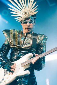 Empire of the Sun. They are so crazy and out there but its awesome!