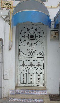 A modern Tunisian door with the Fatimahand, via Flickr.