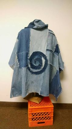 A hooded poncho made from recycled denim jeans. Free size, suitable for most. Measurements: 35 from top of shoulder straight down front 23 from