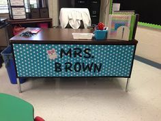 Wrapping paper What a great idea to spruce up a teacher desk!  Love it!