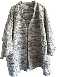 Norn Jacket by Linnemann, sustainable luxury lifestyle brand by textile designer Stine Linnemann. Unisex unisize style in handspun and handwoven certified fairtrade fabric from Ethiopia. Designed and made in Denmark.