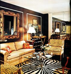 The Peak of Chic:  Ferris Megarity's Manhattan apartment in Architectural Digest, March/April 1975 - Dark walls, buttery and animal print upholstery