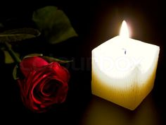 Stock image of 'Candle and red rose in the night'
