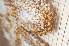 Arquicostura Raquel Rodrigo cross stitching installation close up on a building
