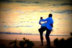 Dance like nobody's watching. We caught these two dancing on the beach in Maui.