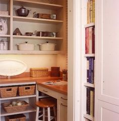 Cookbook recess shelving next to the refrigerator, neat use for unused space.