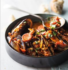 Mussels and chorizo in chilli-tomato sauce | Woolworths TASTE