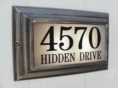 Edgewater Large Lighted Address Plaque - Give your home the mark of distinction with one of these bright and durable lighted address plaques. Cast aluminum frame won't rust, rot or crack. Tough, high impact acrylic polymer lens. Available in eight finishes. Vinyl Clarendon numbers standard, optional cast aluminum or solid brass raised numbers to match the frame.
