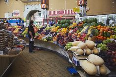 This is a vendor selling fruits at Bessarabsky Market in Kiev, Ukraine.