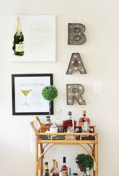Want to add a bar cart to your home but don't know where to start? You've come to the right place! Bar carts are a huge trend that we are certainly on board with, but it can be hard to find out exactly what to add to your bar cart or how to even start… Home Bar Decor, Bar Cart Decor, Target Home Decor, Ikea Bar Cart, Diy Bar Cart, Kitchen Bar Decor, Home Bar Signs, Pub Decor, Kitchen Cart
