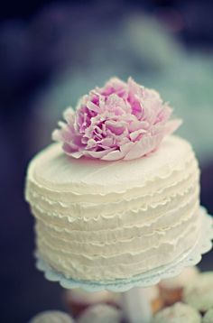 simple cake top for cutting- love the light frosting and decorated with flowers- roses or vibrant colors
