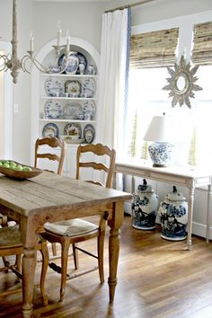 Holly Mathis' pretty dining room (BM Edgecomb Gray walls, SW Pure White trim, Circa Country Chandelier)
