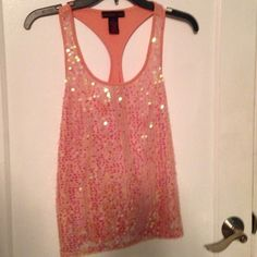 Material Girl Sequin Racer back Tank Top NWOT MATERIAL GIRL SIZE X-SMALL SALMON PINK STRETCHY TANK TOP/BLOUSE IRRIDESCENT SEQUINS ON FRONT MAKE THIS SHIMMER BEAUTIFULLY NEVER WORN Material Girl Tops Tank Tops