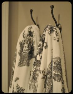 I have two white terry cloth Restoration Hardware robes behind the guest bath room... For guests. :)