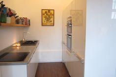 Small, tiny, white, modern kitchen