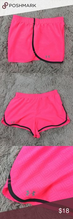 "Under Armour 'See Me Go' Breast Cancer Awareness WOMEN'S UNDER ARMOUR HEAT GEAR 'SEE ME GO' BREAST CANCER AWARENESS RUNNING SHORTS. MATERIAL: 100% POLYESTER SIZE: XS MEASUREMENTS: ~ WAIST LAYING FLAT 13""  ~ TOTAL LENGTH 11"" THEY ARE IN GREAT CONDITION AND THEY ARE FREE OF FLAWS. Under Armour Shorts"