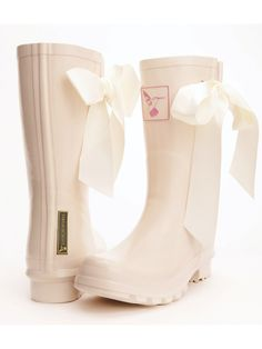 Gorgeous cream wedding day wellies with a silk ribbon tie feature to the side of the leg. Perfect for the bride or bridesmaids.