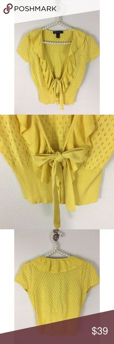 INC International- Vintage Style Cardigan Sz SM Canary Yellow pointelle knit with ruffle neckline , sweater has some stretch, ribbing at waist , covered buttons with cute tie detail. Sz Small - 60% Silk and 40% Cotton. Bust is 16.5 inches measured flat underarm to underarm. Length is 18 inches from shoulder to hem. Really sweet little sweater with a vintage vibe to it, in excellent pre owned condition. INC International Concepts Sweaters Cardigans