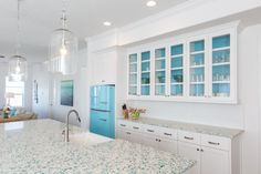 Floating Blue Vetrazzo counters inspire the palette of this beach house by Laura U Interiors. Pic: Julie Soefter
