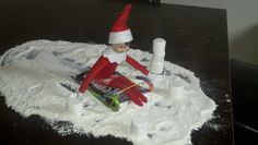 Elf on the Shelf built a sled & went sledding with flour & make snowballs with marshmallows