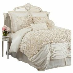 "Add feminine-chic flair to your master suite or guest bedroom with this faux silk comforter set, showcasing layers of ruched detailing and hand-sewn bows.      Product: Queen: 1 Comforter, 1 bed skirt, and 2 standard shamsKing: 1 Comforter, 1 bed skirt, and 2 king shamsCalifornia King: 1 Comforter, 1 bed skirt, and 2 king shams   Construction Material: Faux silk Color: Ivory Features:  Hand-sewn detailing 14.5"" Bed skirt drop  Dimensions: Standard Sham: 20"" x 26""  King Sham: 20"" x …"