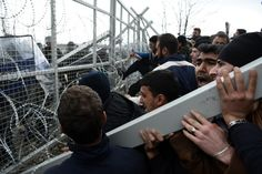 03/01/2016 - Migrants try to storm Greece-Macedonia border fence - Idomeni, Greece: Hundreds of refugees on Monday tried to break through a border fence into Macedonia from Greece, where more than 7,000 people are stranded, as anger mounted over barriers to entry imposed on migrants.