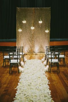 Beautiful gold sparkly backdrop for ceremony.  Love the white rose petals and candles, too! | http://emmalinebride.com/2016-giveaway/sparkly-wedding-accessories/