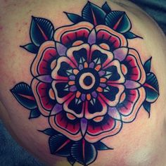 Geometric Traditional tattoo - I think this tattoo is a great example of how two styles can be mixed together to create a great design. Also, I like that the artist hasn't used the traditional colours.