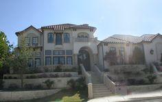 Santorini House Plan: 2 story, 6956 square foot, 4 bedroom, 5 full bathrooms