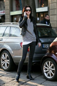 Black ankle boots, skinny jeans, leather jacket; grey sweatshirt