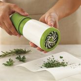 """Microplane Herb Mill:  """"Place mint, oregano, sage and other fresh green leafy herbs in this mill, then just twist the handle – the ultra-sharp scissoring blades quickly mince even large quantities of herbs for flavorful salad dressings, sauces and more."""""""