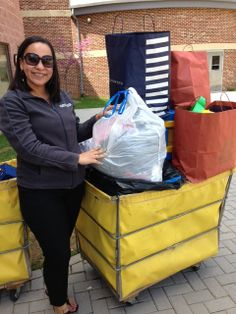 Michelle Smith posing with all of the generous donations made by PI employees