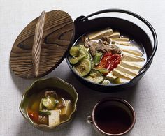 Dubu-jeongol, Tofu Hot Pot: A moderately spicy and well-presented hot pot, made with tofu, beef, and vegetables. It is cooked at the table