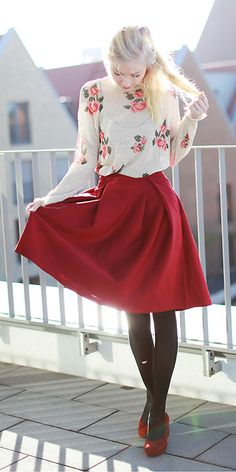romantic style. a-line candy apple red skirt, black tights, open-knit floral sweater & darling shoes.
