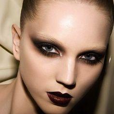 Burnt Plum Smokey Eyeshadow, Bleached Blonde Brows, and Dark Plum Lips. Editorial Makeup.