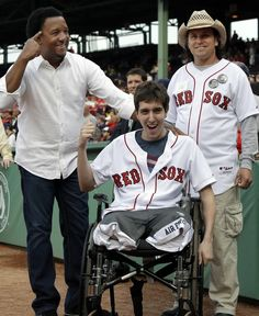 Boston Marathon bombing survivor Jeff Bauman (center), poses with former Boston Red Sox pitcher Pedro Martinez (left), and Carlos Arredondo (right), the hero in a cowboy hat man who helped save his life.  Bauman was invited to throw the first pitch at a Red Sox-Phillies game at Fenway Park, May 2013 (photo by Elise Amendola)