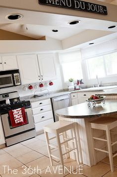Red Accents In A White Kitchen